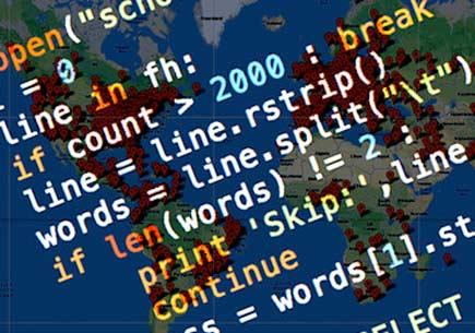 Programming code skewed over a world map. Image credlt: Coursera