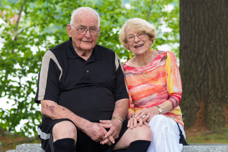A happy senior couple sitting together outside. Image credit: Ian Russell
