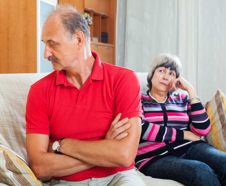 An older couple after an argument. (stock image)