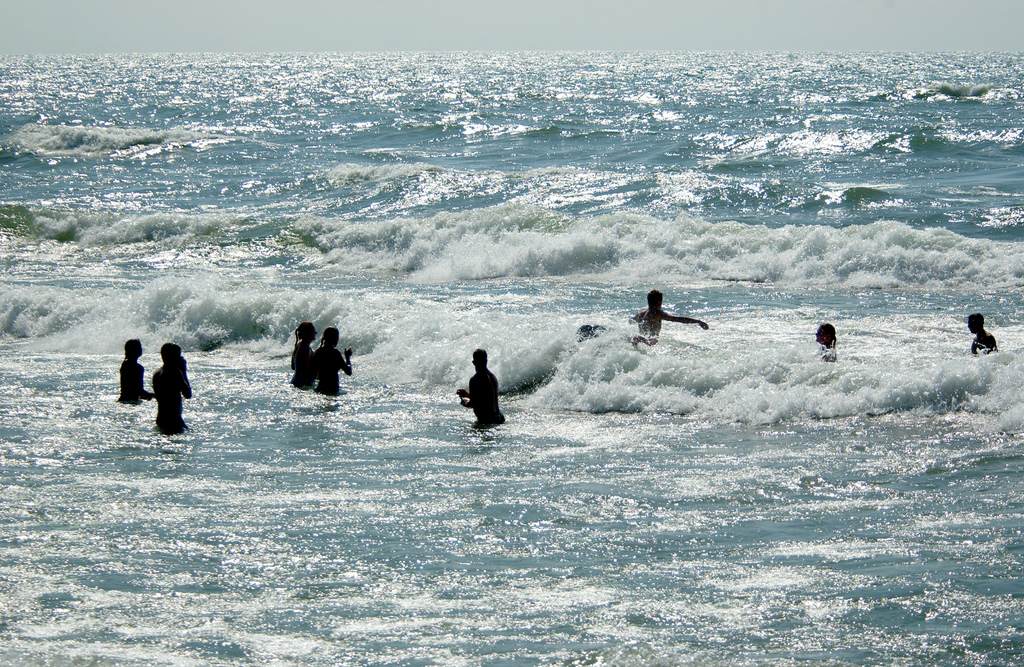 Swimmers playing in the surf, Lake Michigan. Image credit: Michigan Sea Grant