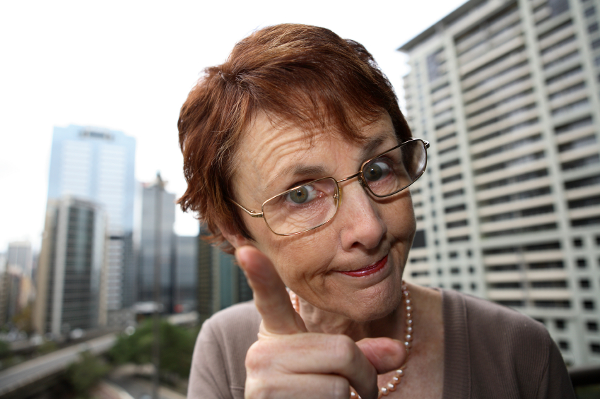 An older woman shakes her finger and advises. (stock image)