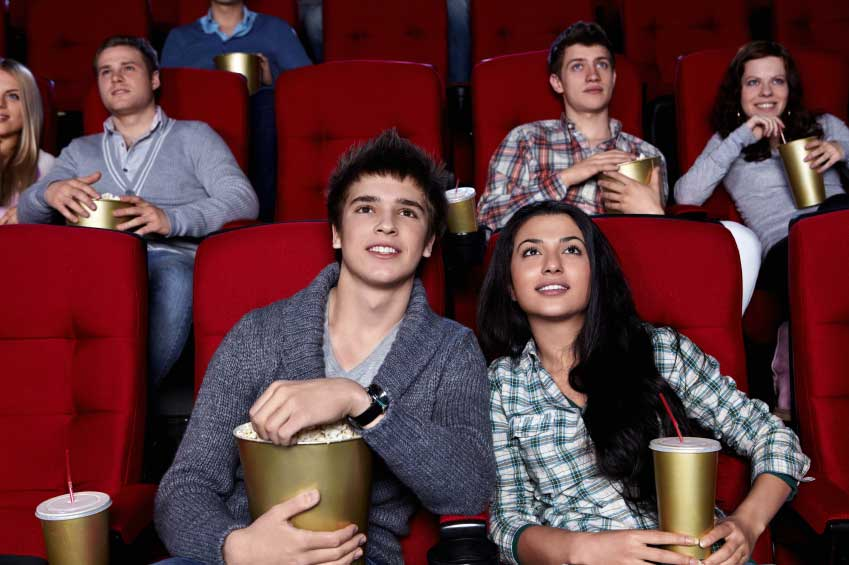 An audience watching a movie in a theater. (stock image)