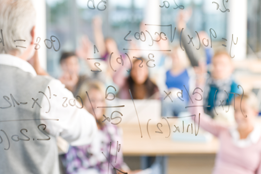 Math lesson in a high school classroom. (stock image)