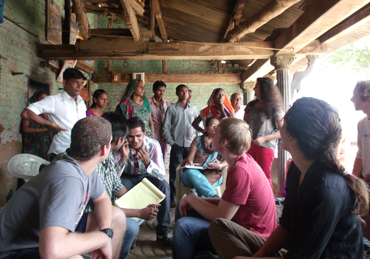 Bluelab India members Zoha Momin, Erica Dombro, Jon Minion and Mike McGahren-Clemens talk to villagers about their needs.