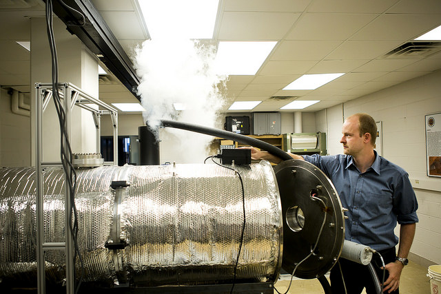 Erik Fischer, AERO PhD Student and AOSS Researcher, sets up a Mars Atmospheric Chamber by running liquid nitrogen to cool down the chamber in the Space Research Building. Image credit: Joseph Xu