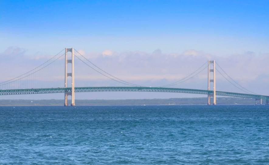 A photo of the Mackinac Island bridge with a cloudy background. (stock image)