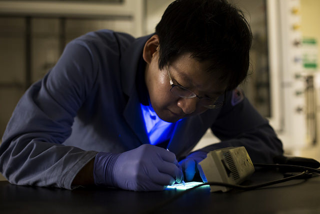 Min Sang Kwon, Postdoctoral Fellow, tests phosphorescent LEDs by writing on them with water in the NCRC in Ann Arbor, MI on July 9, 2014. Image credit: Joseph Xu