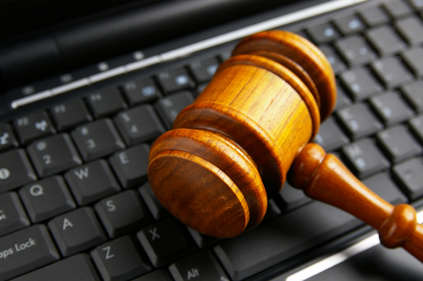 A gavel sits on a computer keyboard. (stock image)