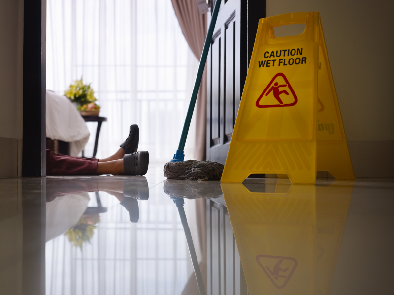 A woman lies on the floor after a fall. (stock image)