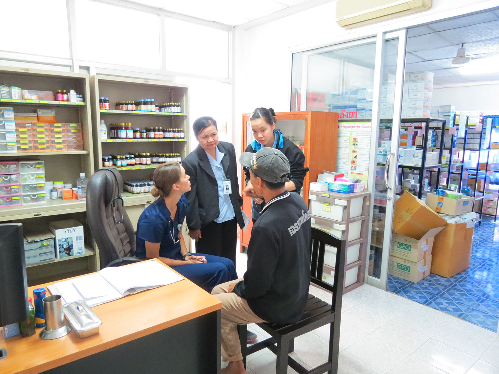 A U-M School of Nursing student cares for a patient in Thailand while a Thai colleague provides translation. U-M has longstanding ties with nursing programs in Thailand. Image credit: U-M School of Nursing