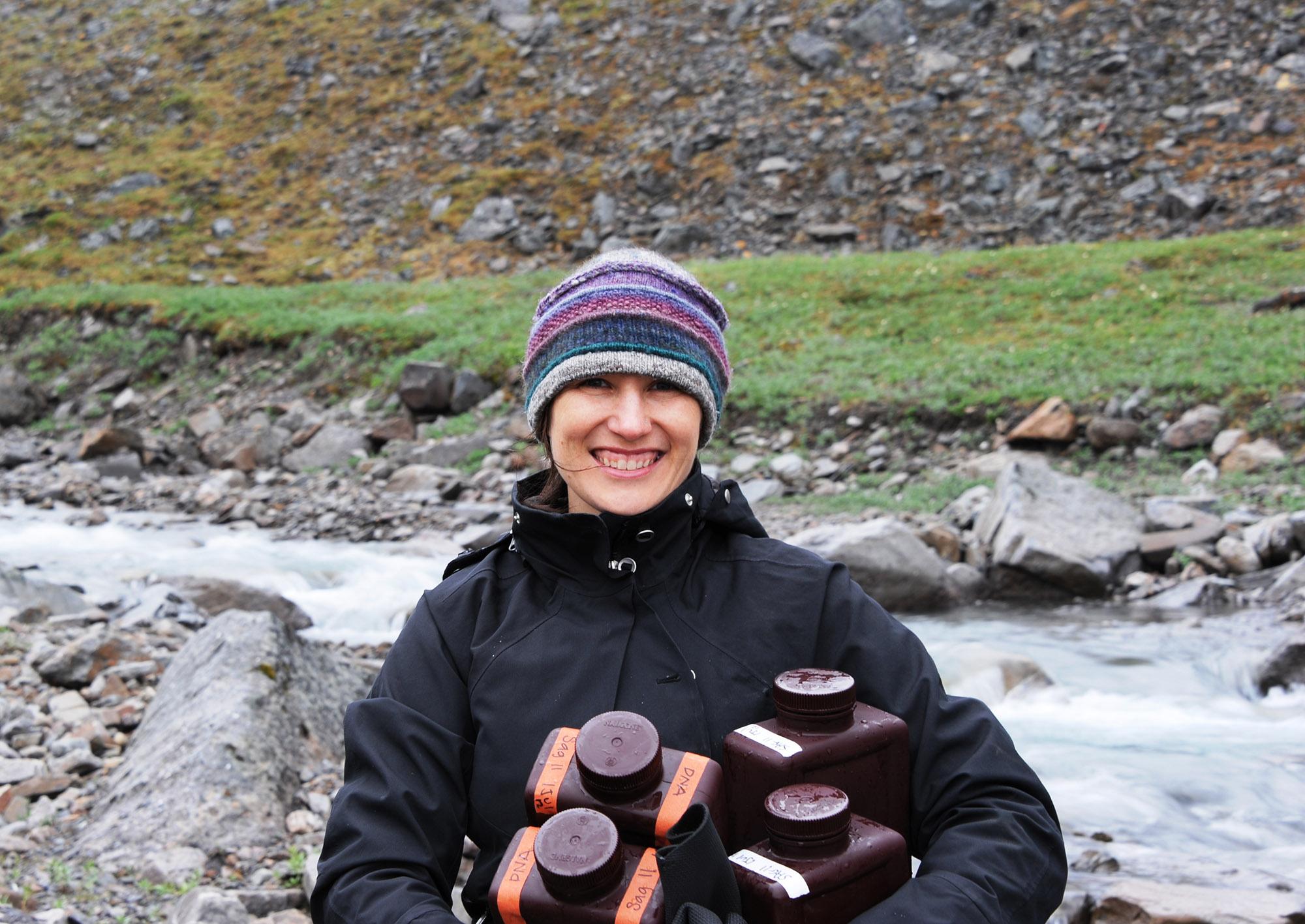 University of Michigan aquatic geochemist Rose M. Cory collects water from the Sagavanirktok River, Arctic Alaska. Image credit: George W. Kling