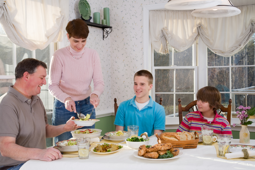 A family dinner. (stock image)
