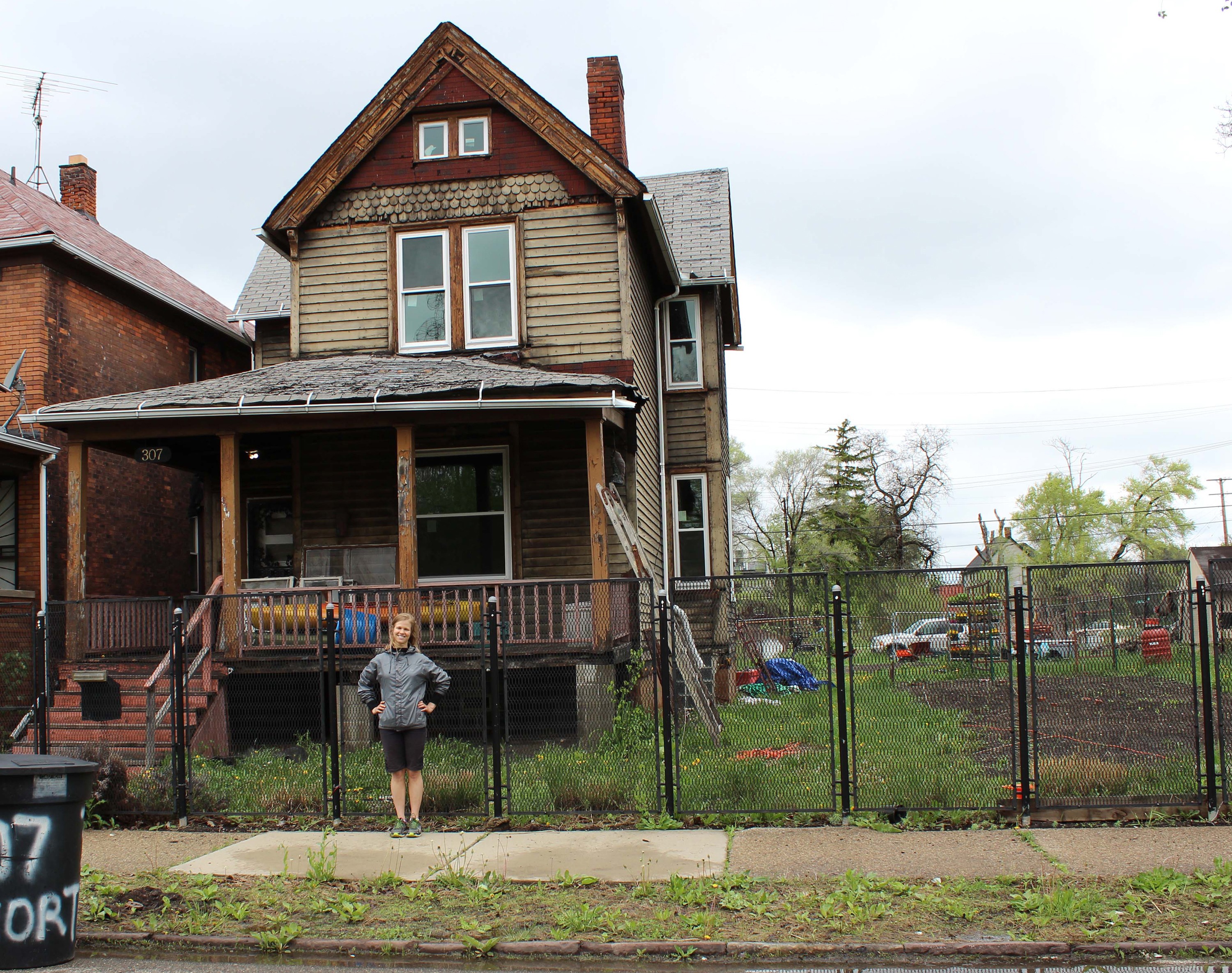 University of Michigan graduate student Lizzie Grobbel in front of the vacant Detroit house where she is raising shrimp, which she hopes to sell to restaurants, markets and others. Image credit: Lisa Pappas