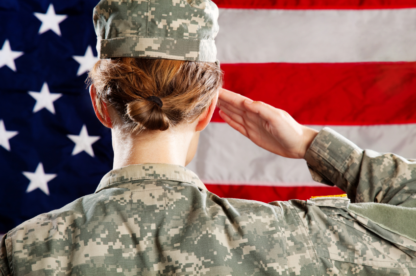 A female soldier solutes the flag. (stock image)