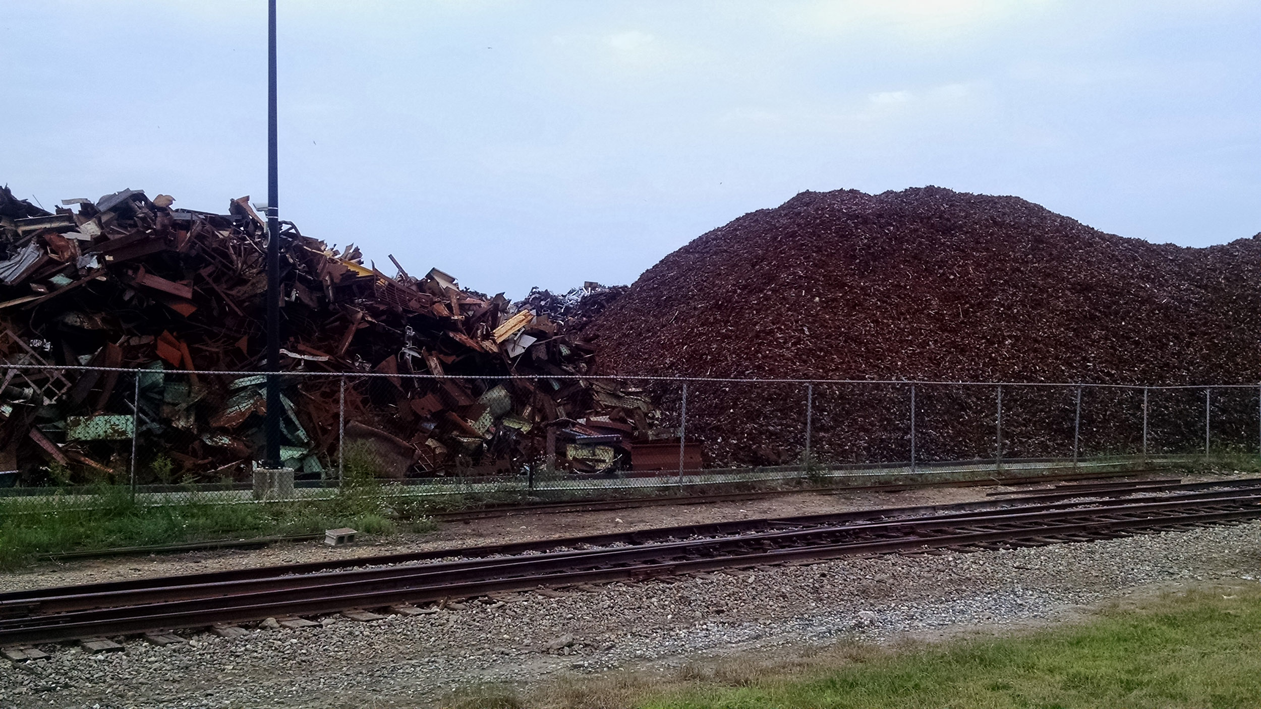 Piles of scrap metal line a railroad transfer station in southwest Detroit. Image credit: Nick Caverly