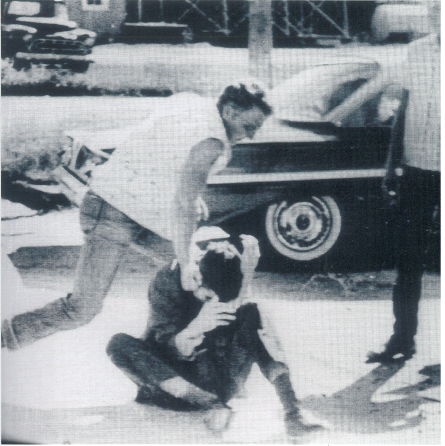 White supremacists pull Tom Hayden from a stopped car and beat him in McComb,  Mississippi, 1961. Image credit: Tom Hayden Papers held at the University of Michigan Library