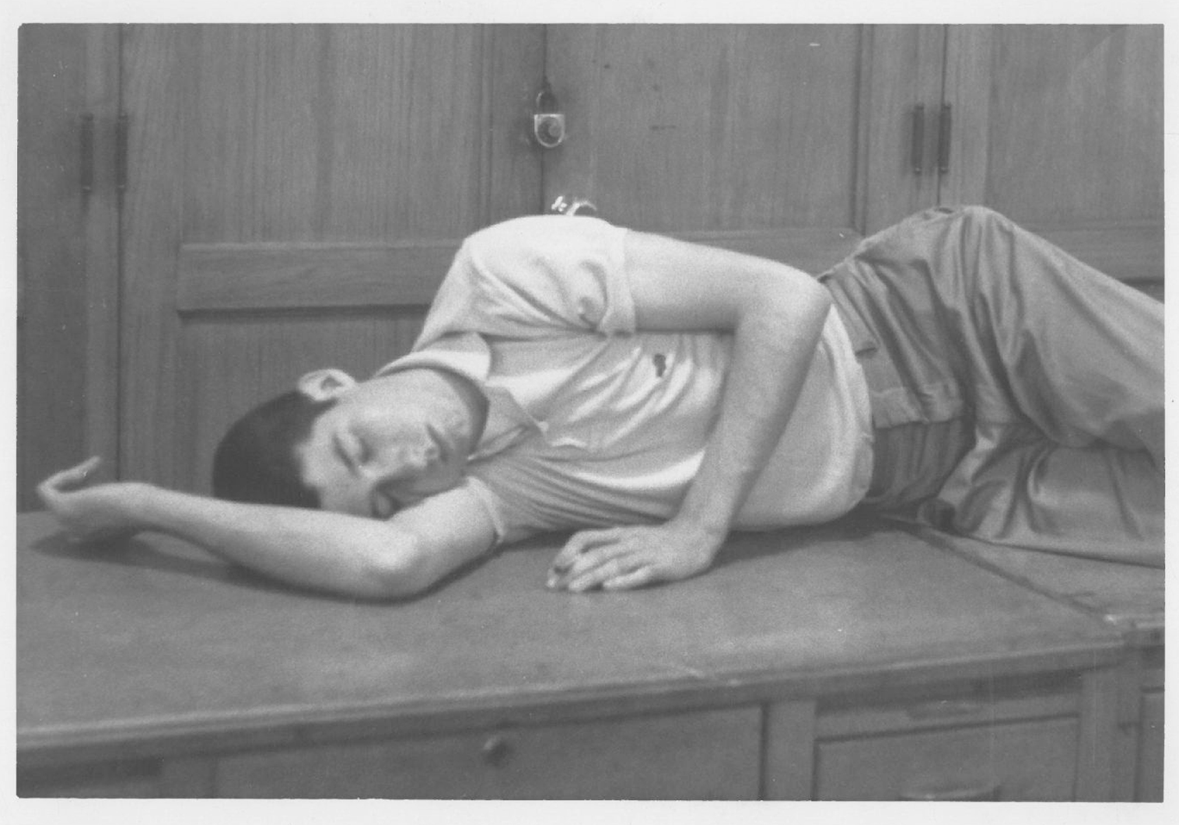Student Tom Hayden asleep on a desk at the Michigan Daily, circa 1960. Image credit: Tom Hayden Papers held at the University of Michigan Library