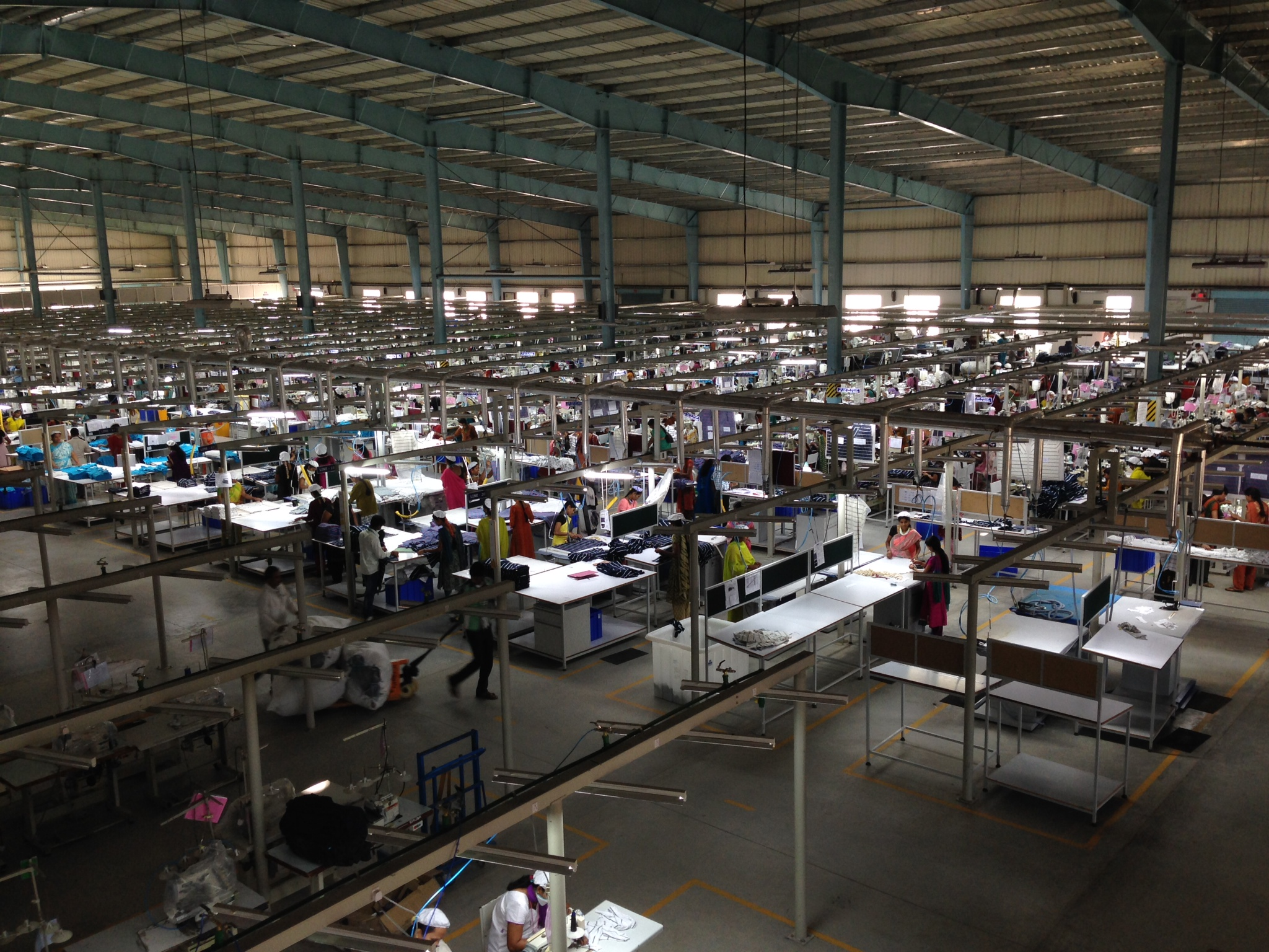 Garment factory in Bangalore, India with fluorescent lighting. Image credit: Achyuta Adhvaryu
