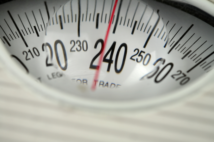 A scale shows 239 pounds. (stock image)