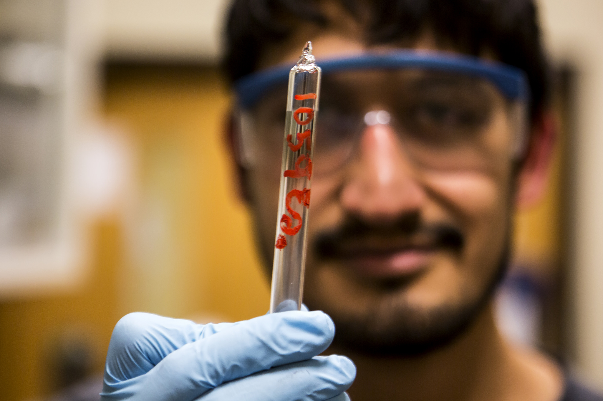"Juan Lopez, MSE PhD Student, constructs a semiconductor used for spintronics in the HH Dow Building on February 6, 2015. The semiconductor has a novel ""low symmetry"" crystal structure that allows for researchers to build spintronic properties into material that is stable and room temperature and can be used for a variety of applications. Image credit: Joseph Xu, Michigan Engineering"