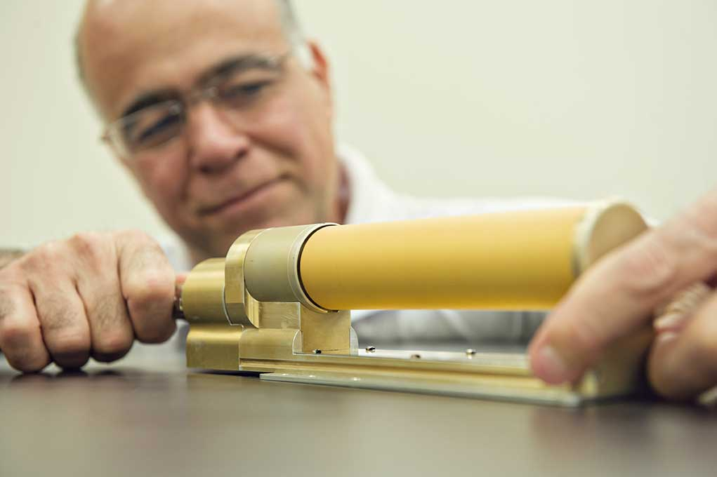 Professor Nilton Renno displays the Charge Tracker, a sensor that uses technology he developed to identify stray voltage from a distance of more than 10 feet. Image credit: Leisa Thompson