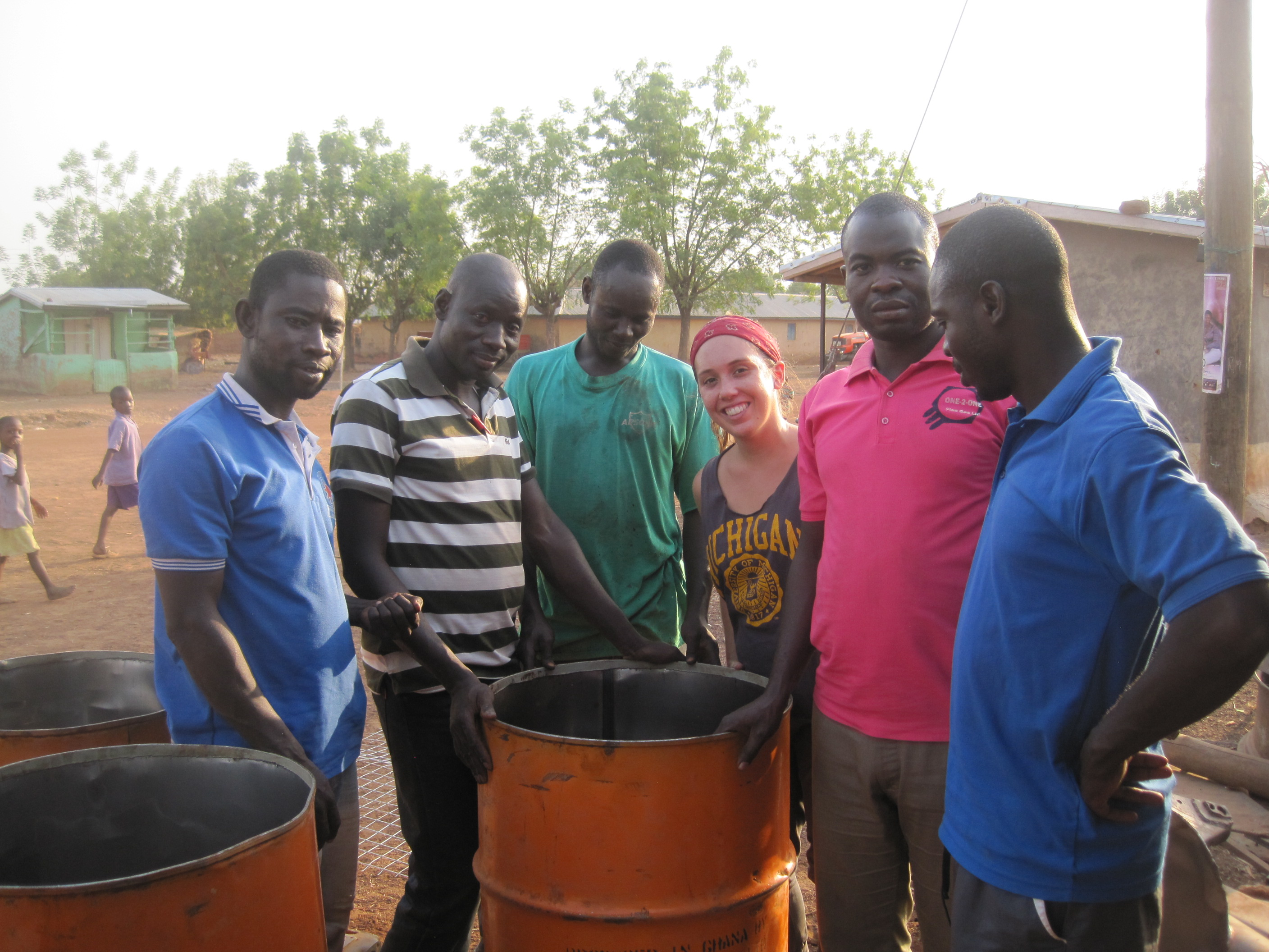 U-M alumna and Peace Corps volunteer Genevieve James gathers with teachers at an incinerator they built for the primary school in her community in northern Ghana. Image courtesy: Peace Corps