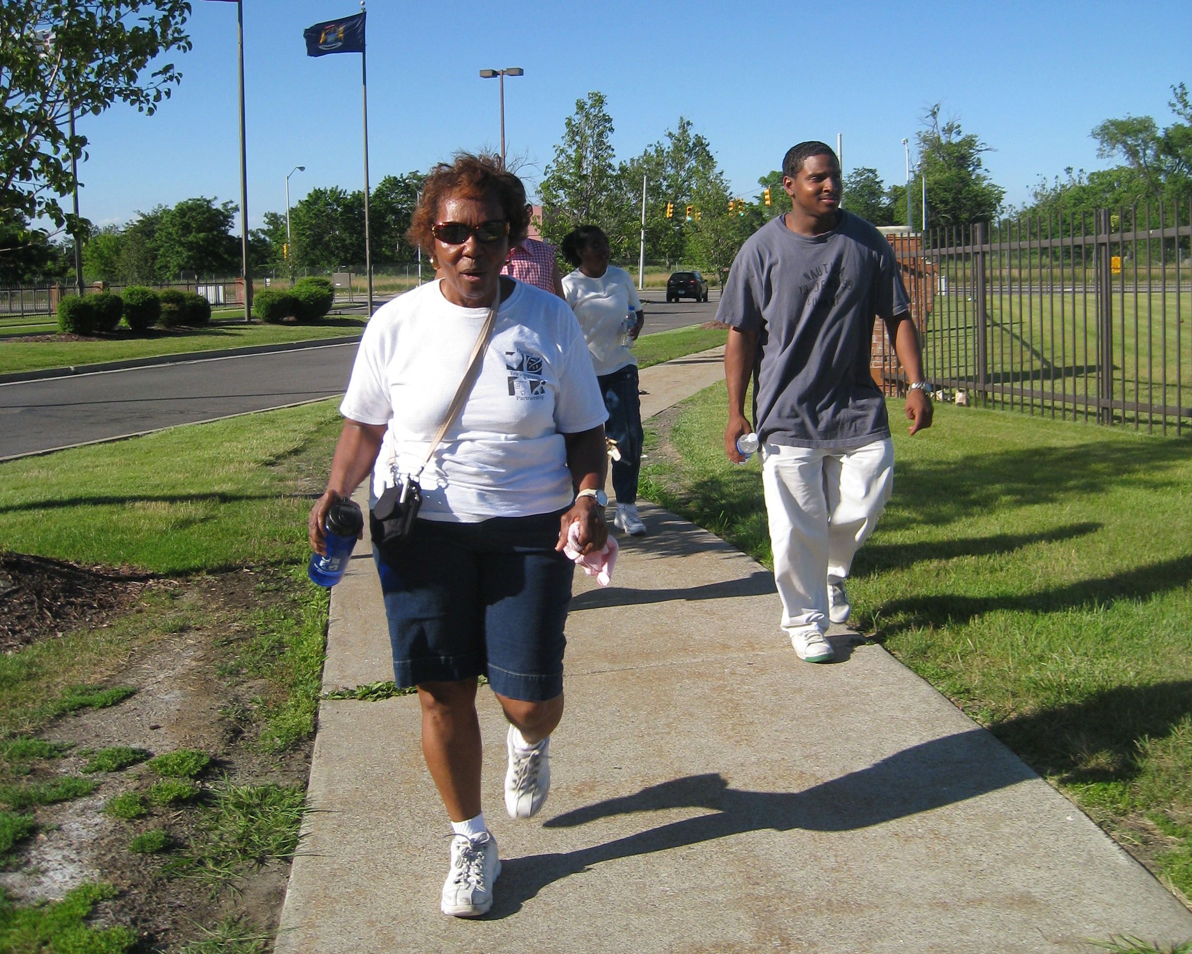 Friends of Parkside walking group in 2009, the year the Walk Your Heart to Health program started. Walkers are Gladys, Maxine and Baraka. Image credit: Betty Izumi