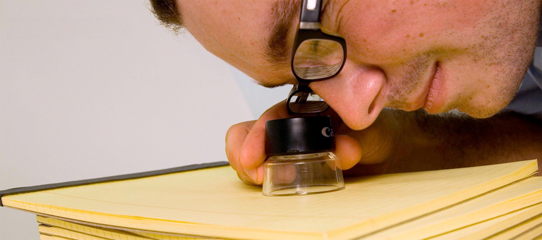 Viewing the micro-printed text through a loupe. Image courtesy: Matt Kenyon