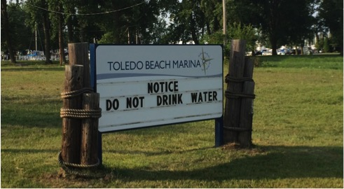 Sign at the Toledo Beach Marina during last August's water crisis. Image credit: Sarah Page