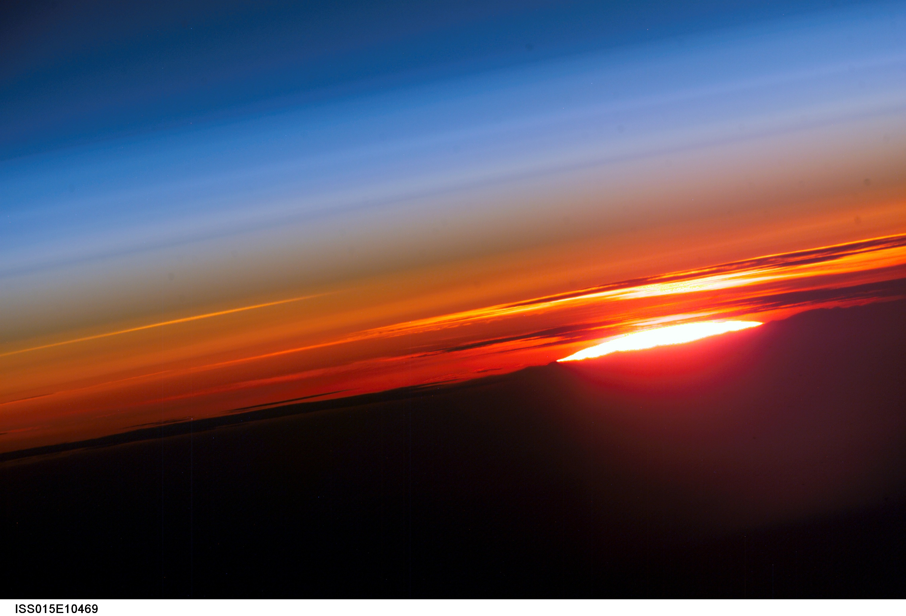 The profile of the atmosphere and a setting sun are featured in this image photographed by an Expedition 15 crewmember on the International Space Station. Image credit: NASA