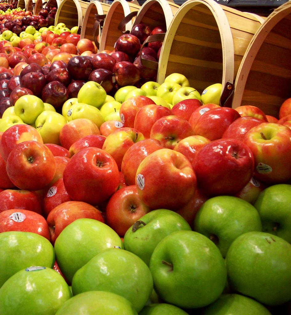 A few bushels of different kinds of apples.