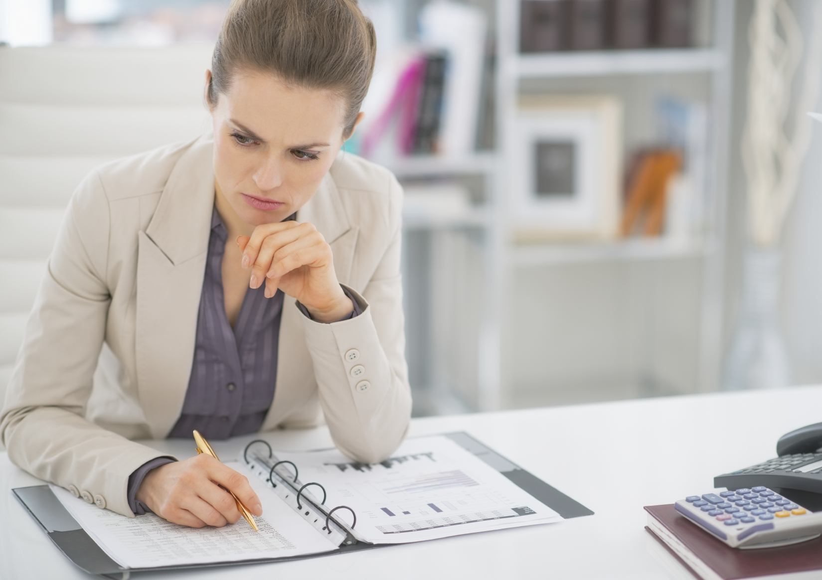 A woman working in finance. (stock image)