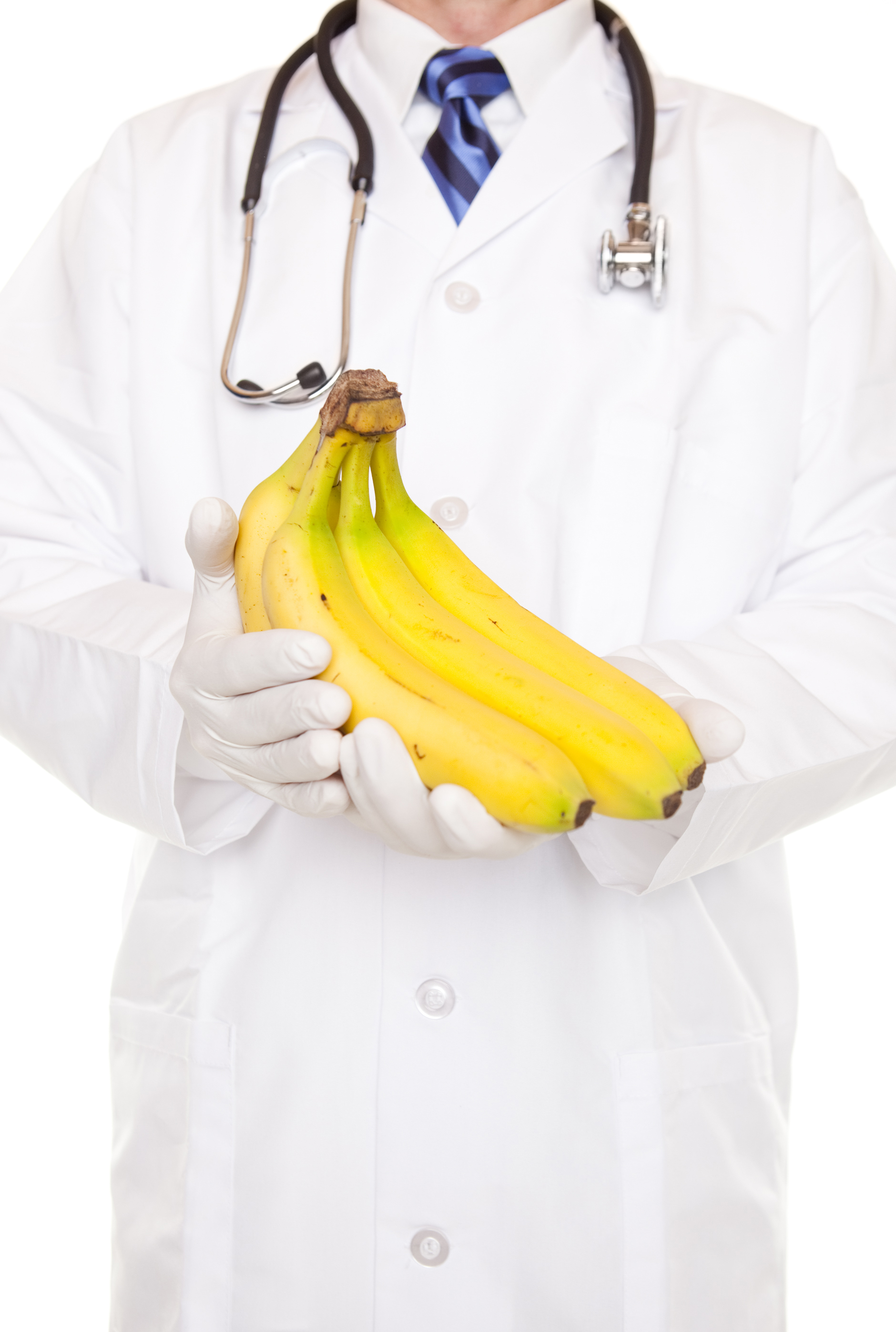 A doctor in a white coat holding a bunch of bananas. (stock image)