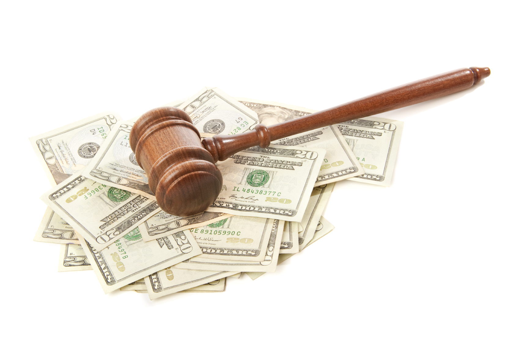 Gavel laying on top of money isolated. (tock image)