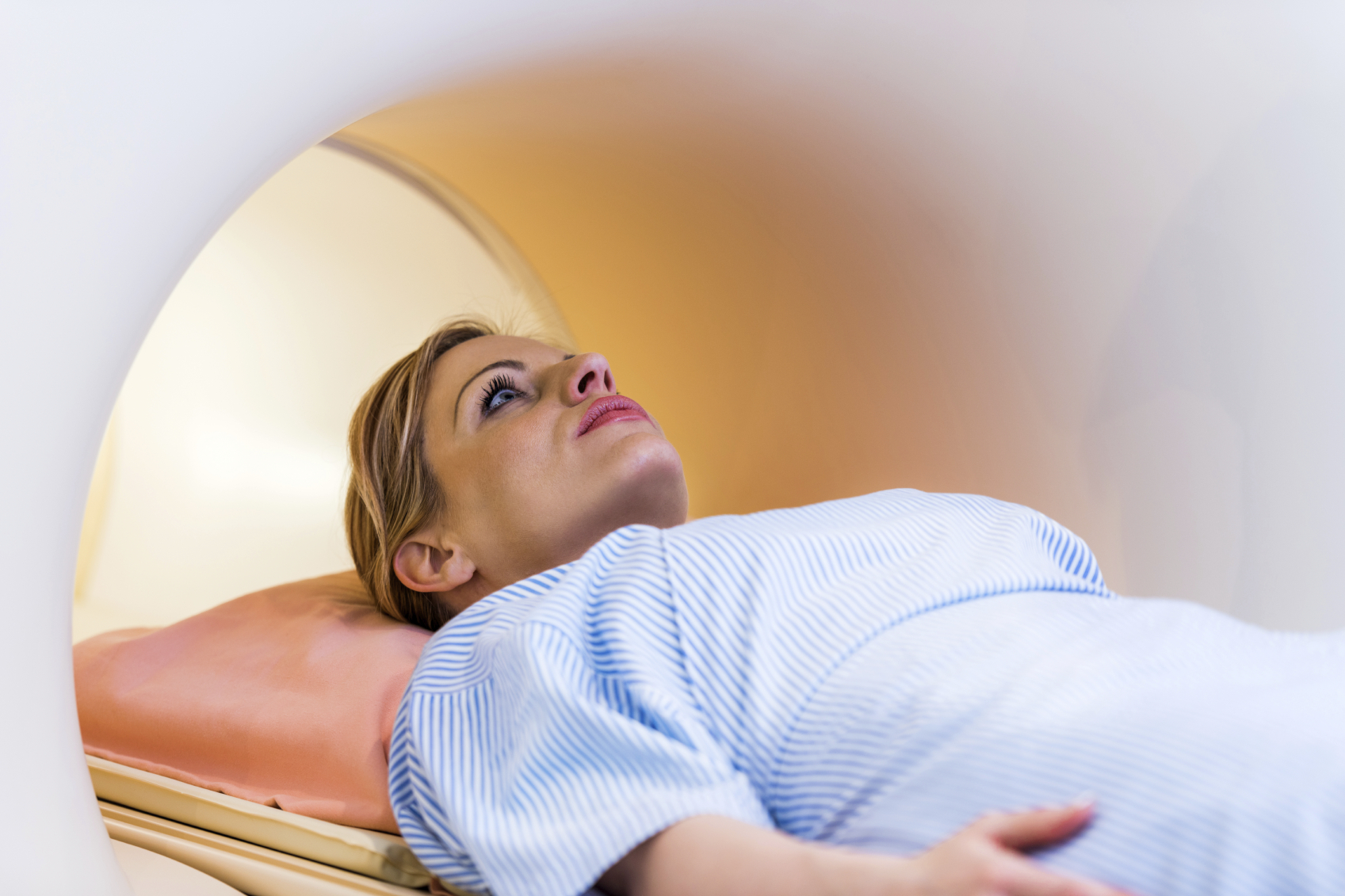 A young woman in an MRI machine. (stock image)