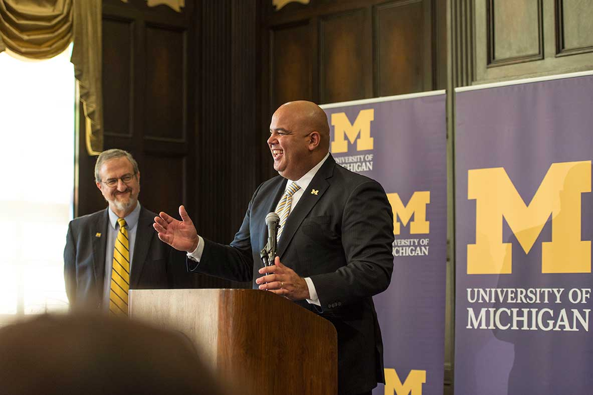 The University of Michigan president Mark Schlissel introduces new athletic director Warde Manuel during a press conference at the Michigan Union on Jan. 29, 2016. Image credit: Michigan Photography
