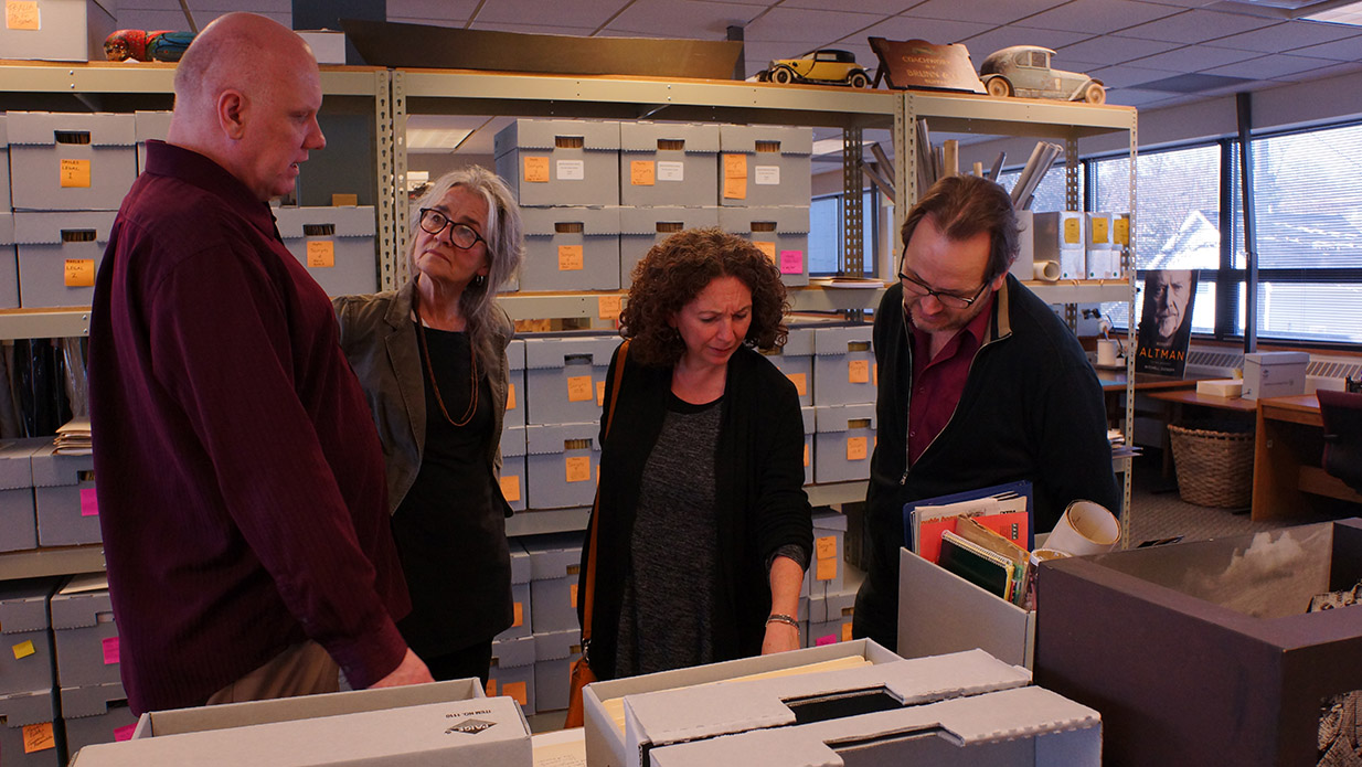 Pictured (left to right): Screen Arts Mavericks and Makers collection curator Philip Hallman, head archivist at the U-M Special Collections Library Kathleen Dow, Nancy Savoca, and Rich Guay during a recent visit to the U-M Special Collections Library, where the Screen Arts Makers & Mavericks Collection is held.