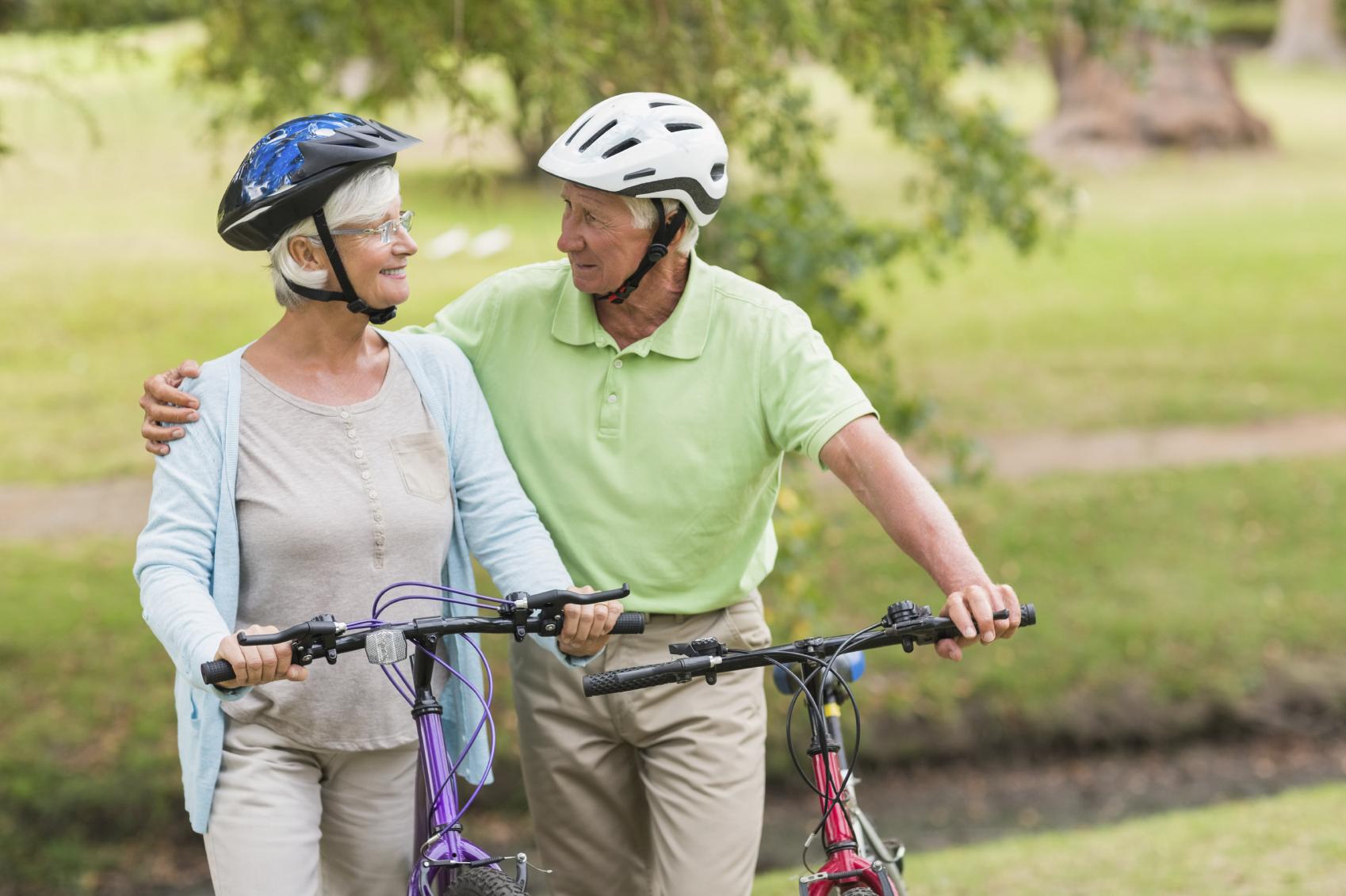 Happy senior couple on their bikes. (stock image)