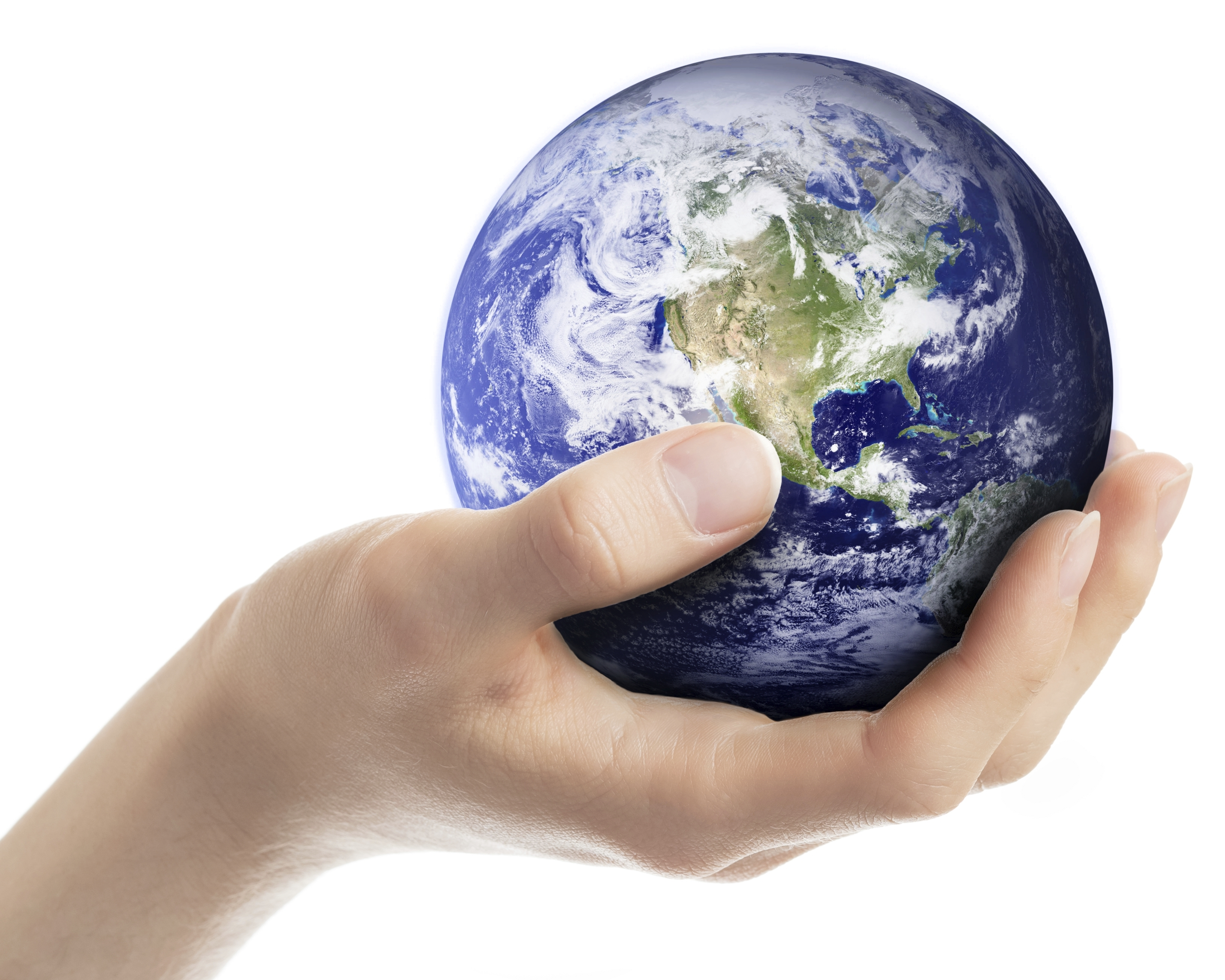 A hand holding a small model of earth. (stock image)