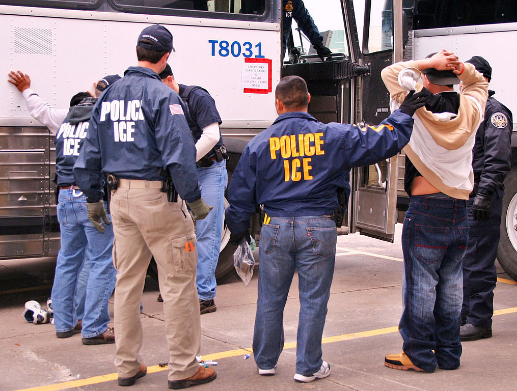 ICE Special Agents (U.S. Immigration and Customs Enforcement) arresting suspects during a 2010 raid in Houston. Image courtesy of ICE via Wikimedia Commons