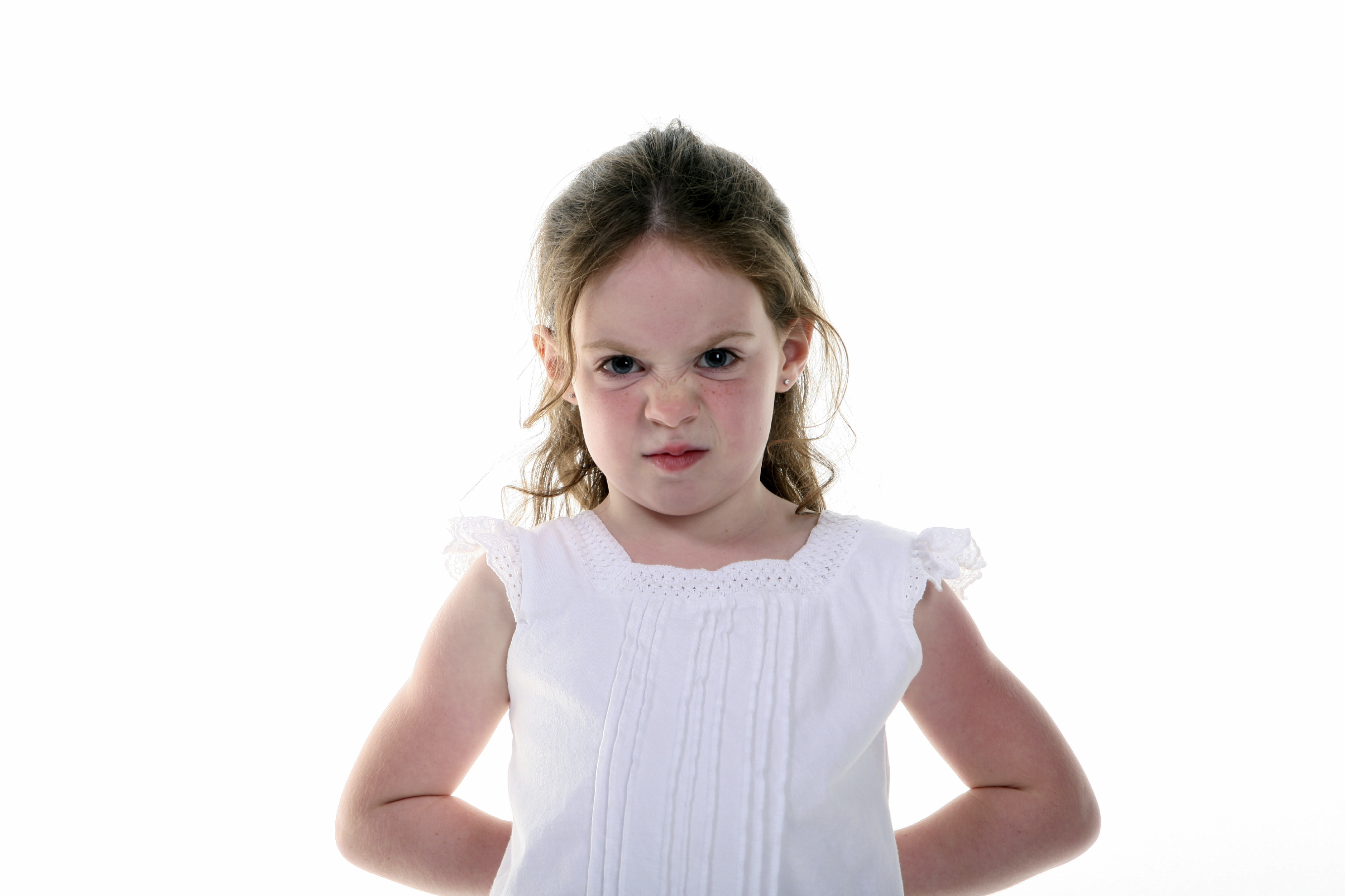 A very young girl with a bratty expression. (stock image)