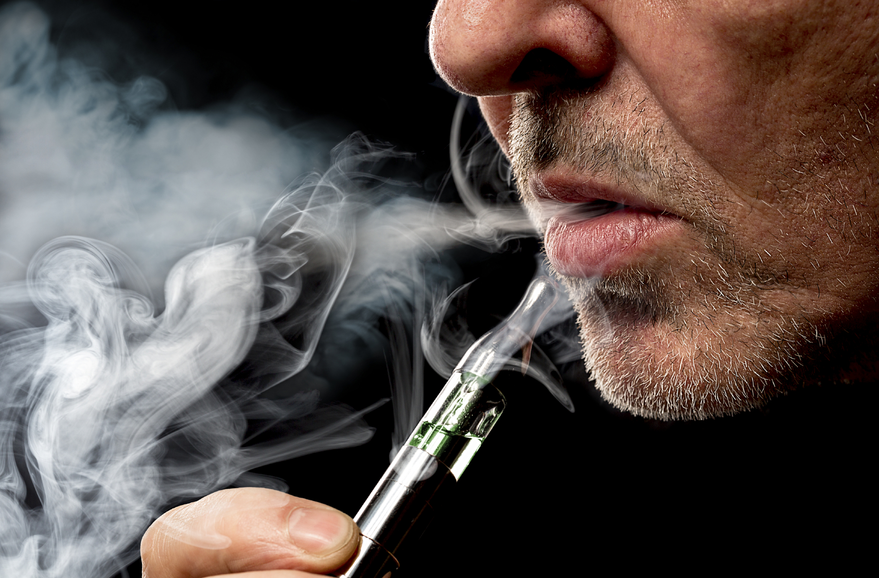 A man smokes an e-cigarette. (stock image)