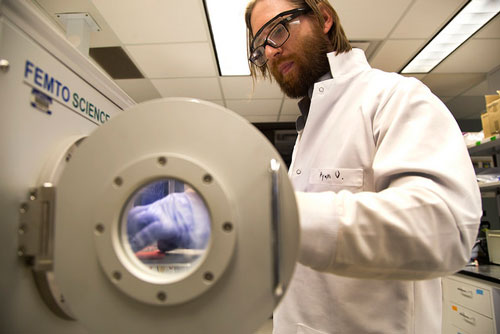 Ryan Oliver, Post-Doctorate Researcher, fabricates a special microchip that can simulate different organs and parts of the body in a plasma chamber. Image credit: Joseph Xu