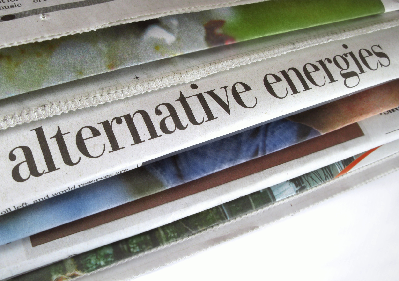 Stack of newspapers with headlines about alternative energy. (stock image)