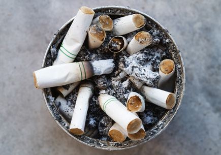 A container filled with cigarette butts (stock image).
