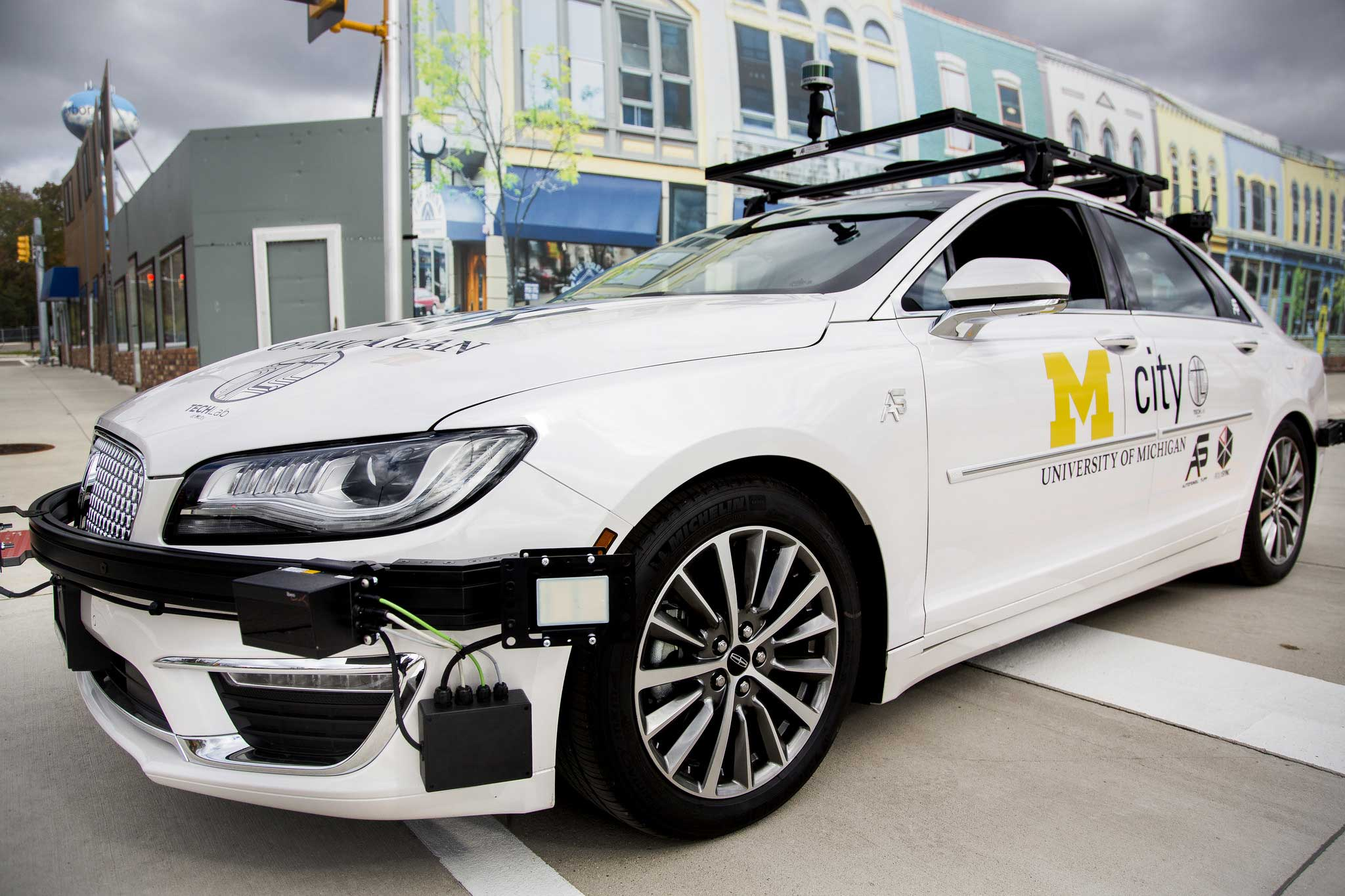 This Lincoln MKZ is an open connected and automated vehicle research platform, or open CAV, at the University of Michigan. It is an open testbed for academic and industry researchers to rapidly test self-driving and connected vehicle technologies at Mcity, a world-class proving ground for advanced mobility vehicles operated by U-M's Mobility Transformation Center. The Lincoln will be joined by two Kia Souls equipped as open CAVs in coming months. Image credit: Joseph Xu, Michigan Engineering