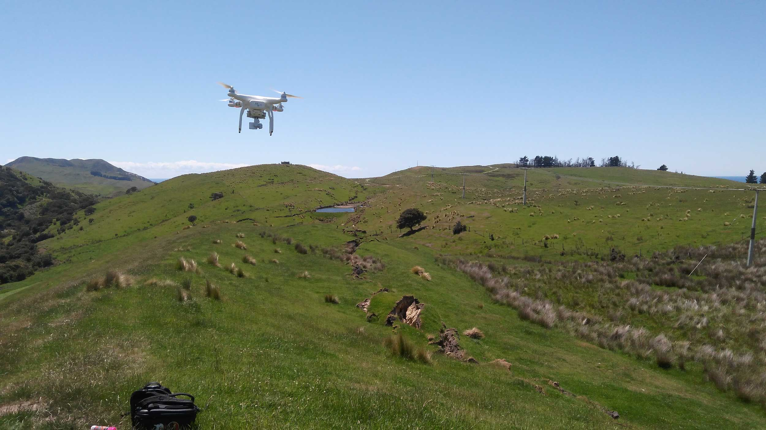 A University of Michigan drone inspecting a fault rupture site in New Zealand. Image credit: John Manousakis