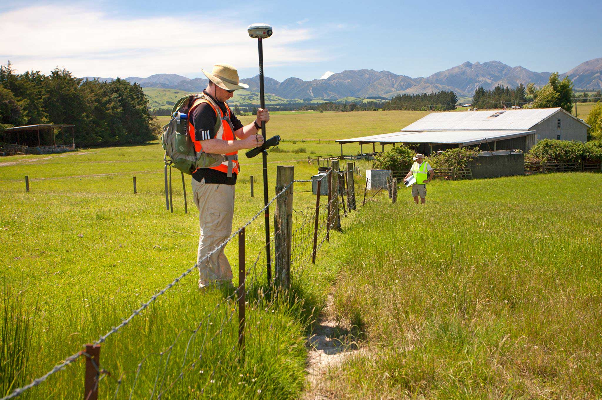 University of Michigan postdoctoral researcher Timothy Stahl uses GPS technology to measure displacement of a fence in New Zealand following November's magnitude-7.8 earthquake. Fence posts in the mid-ground were moved to the right by motion of the fault during the earthquake. Image credit: Kate Pedley