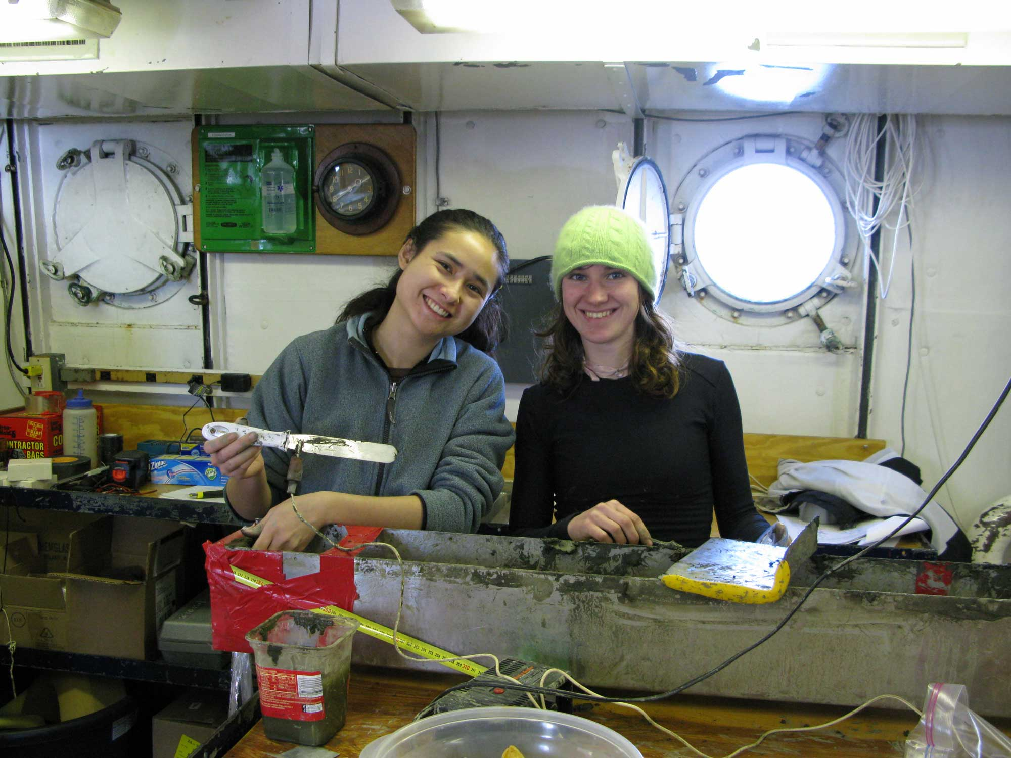 Former University of Michigan graduate student Karla Knudsen, left, and former U-M undergraduate Athena Eyster sample deep-sea sediment collected in 2009 with a coring device beneath the Santa Barbara Channel in California. The sediments were used in a fish-scale analysis. Image credit: Ingrid Hendy