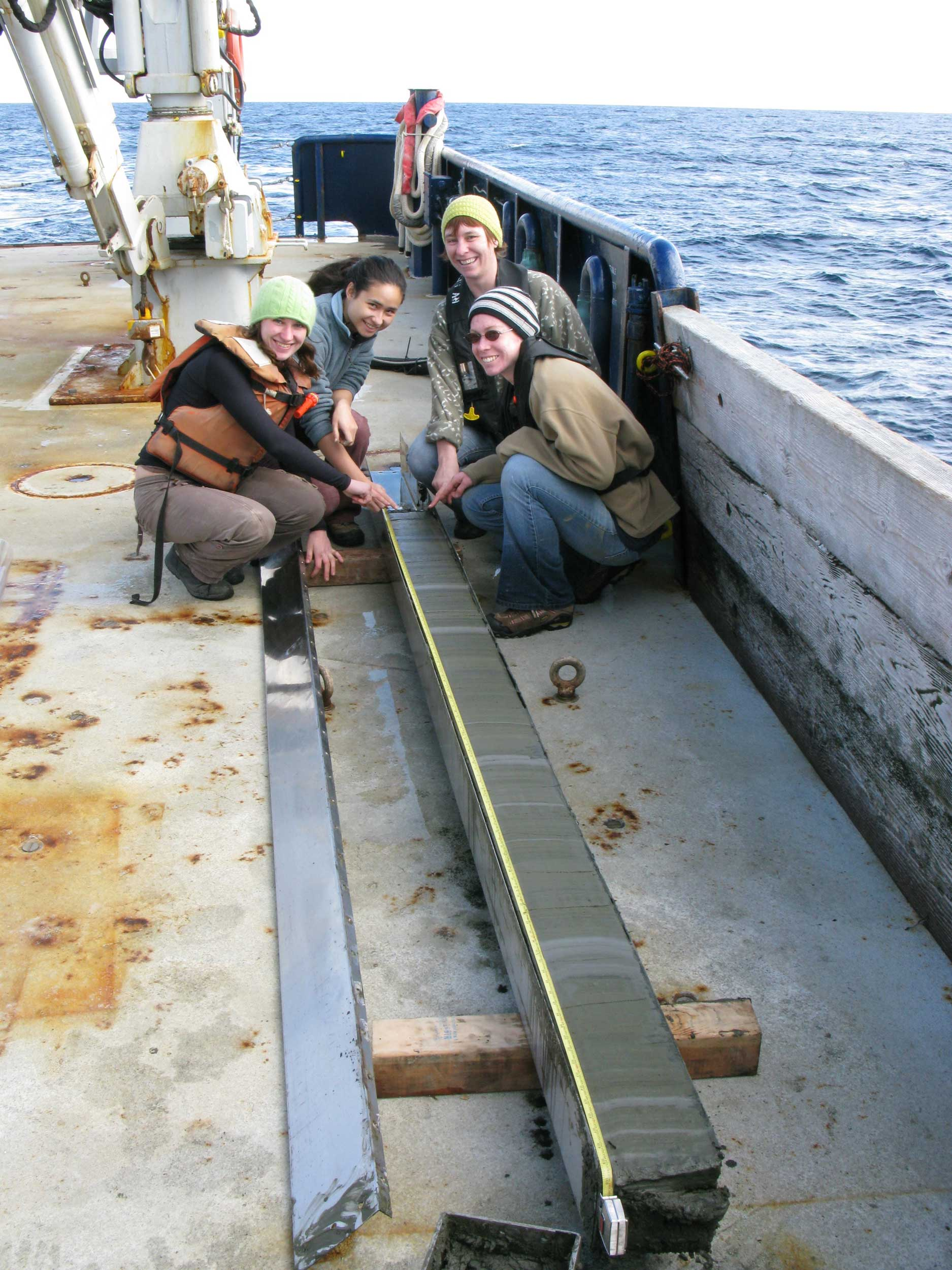 From left to right: Former University of Michigan undergraduate Athena Eyster, former U-M graduate student Karla Knudsen, Ingrid Hendy and former U-M graduate student Meghan Wagner examine a sediment core collected in the Santa Barbara Channel, California, in 2009. Image credit: Arndt Schimmelmann